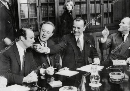 Conductor Sir Malcolm Sargent Offers A Light To Acker Bilk. Chris Barber Makes Up The Trio.