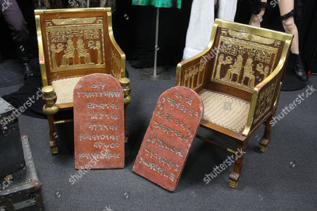 The Ten Commandments (1956) - tablets carried by Charlton Heston. Estimate: $28,000.00 - $34,000.00 Screen used Egyptian chair. Estimate: $7,000.00 - $9,000.00