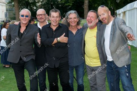 (L-R) Dennis Greaves, Mark Feltham, Gerry McAvoy and Brendan O'Neill of Nine Below Zero with Glenn Tilbrook and Simon Hanson of Squeeze backstage