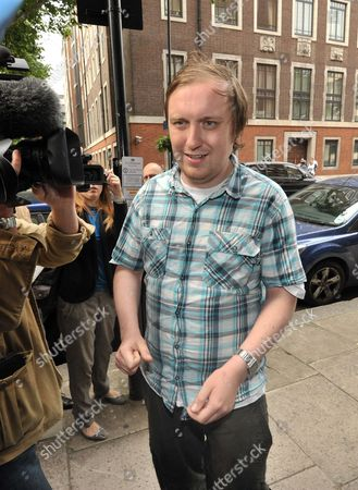 Stock Photo of Jonnie Marbles  arrives at Westminster Magistrates court for his first hearing after he threw a foam pie at Rupert Murdoch as he was giving evidence at a select comittee.