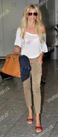 Editorial image of Dani Behr at Heathrow Airport, London, Britain - 31 Jul 2011