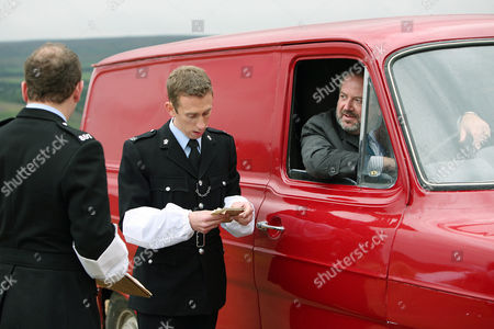 Picture:Frank Carter [David Fleeshman] being questioned by PC Younger [Steven Blakeley] and PC Wetherby [Rupert Ward-Lewis]