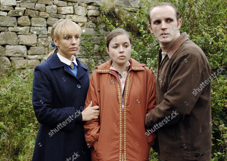 Stock Picture of Carol Cassidy comforts Peter's parents as they fear the worst.  Pamela Morley [Maeve Larkin] and Ray Morley [Matthew Lewney]