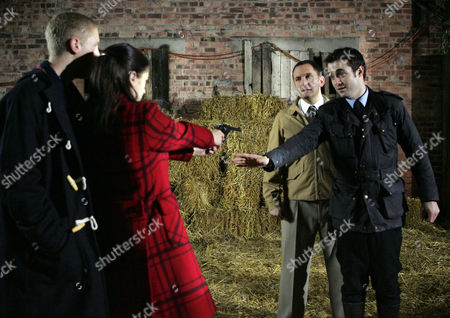 Gary Bell [Joel Cheetham] Handing Over Osgood's Gun to Wendy Kelshaw [Paula Lane], Jim Osgood [Joel Beckett] and Mason [Joe McFadden].