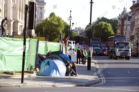 Parliament Square Protesters On The Pavement Next To Brian Haw Today. By Jeremy Selwyn Brian Haw Died 18/6/2011