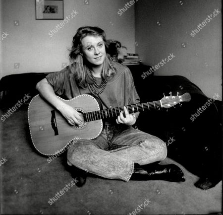 Actress Cathryn Harrison At Home In Battersea Playing Her Guitar