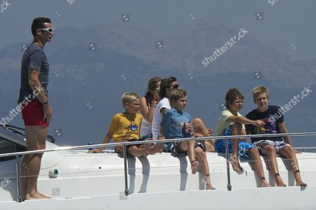 Stock Image of Palma's Duke Inaki Urdangarin (L), his sons Prince Miguel (2L), Prince Pablo Nicolas (3L) and Prince Juan Valentin (2R) and Princess Elena (C-up) her son Prince Felipe Juan Froilan (4R) and  Maria Zurita (3R) watch the last stage of the 30th King's Sailing Cup aboard 'Sommi' ship held in Palma de Mallorca