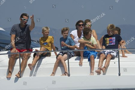 Palma's Duke Inaki Urdangarin (L), his sons Prince Miguel (2L), Prince Pablo Nicolas (3L) and Prince Juan Valentin (2R) and Princess Elena (C-up) her son Prince Felipe Juan Froilan (4R) and Princess Victoria Federica (R) and Maria Zurita (3R) watch the last stage of the 30th King's Sailing Cup aboard 'Sommi' ship held in Palma de Mallorca