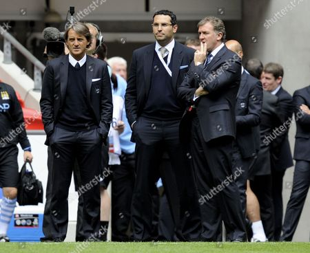 Stock Picture of Manchester City manager Roberto Mancini, chief executive Garry Cook and chairman Khaldoon Al Mubarak talk prior to kick-off
