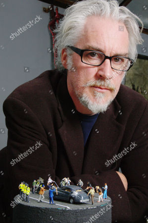 Stock Picture of Jimmy Cauty with his model of Charles and Camilla being attacked, part of his 'I Predict A Riot' exhibition