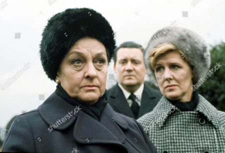 Stock Image of Coronation Street: 6th March 1974 Cyril Turpin Funeral L-R Betty Turpin [Betty Driver] and Maggie Clegg [Irene Sutcliffe] with Alf Roberts [Bryan Mosley] at back.