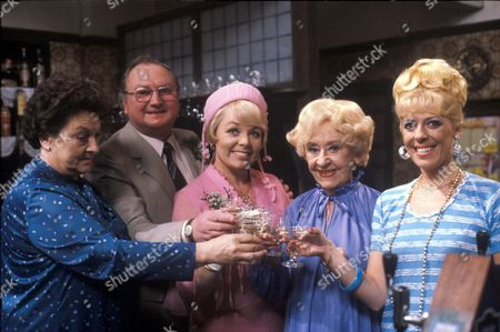 Stock Photo of Coronation Street: 1981 Fred Gee (Fred Feast) and Eunice Nuttall (Meg Johnson) [3rd left] at their wedding reception in the Rovers.  Also pictured Betty Turpin [Betty Driver], Annie Walker [Doris Speed] and Bet Lynch [Julie Goodyear]