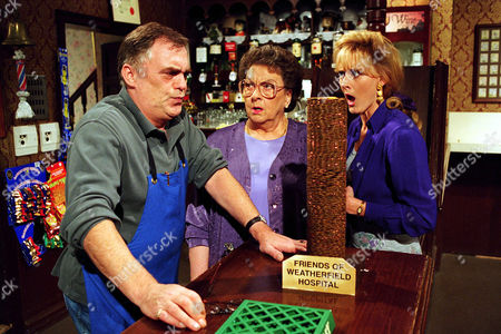"Coronation Street: 23rd September 1994 ""If you concentrate hard enough on that pile of coins, you can get 'em to fall over just by sheer will-power"" Jack Duckworth [William Tarmey] tells Betty Turpin [Betty Driver] and Raquel Wolstenhulme [Sarah Lancashire]."