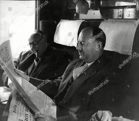 Baron Beeching (doctor Richard Beeching) Chairman Of British Railways Seen Here In Train Carriage With Copy Of Daily Mail.