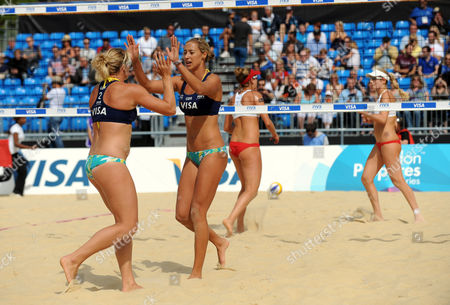 Denise Johns (right) and Lucy Boulton (GBR) celebrate winning a point