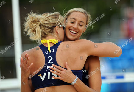 Lucy Boulton (GBR) and Denise Johns hug after winning a point