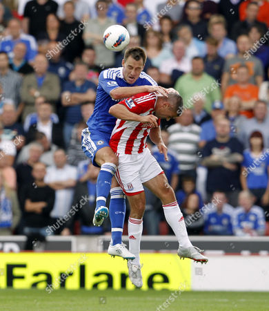 John Terry of Chelsea crashes into Jonathan Walters of Stoke City