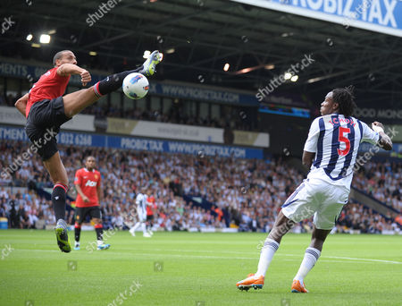Rio Ferdinand of Manchester United clears the ball under pressure from Somen Tchoyi of West Bromwich Albion