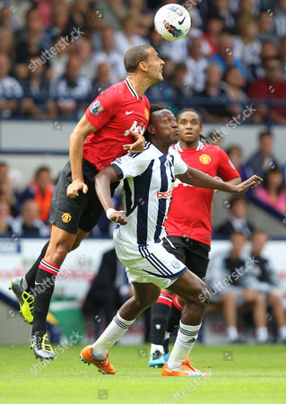 Rio Ferdinand of Manchester United in action with Somen Tchoyi of West Bromwich Albion