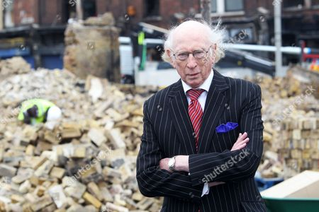 Maurice Reeves in front of the remains of Reeves Corner Furniture Store