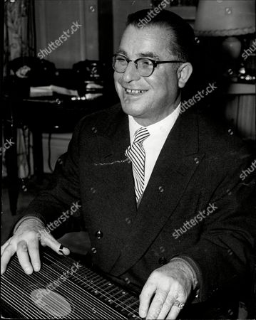 Editorial image of Mr Anton Karas And His Zither Are In This Country On A Flying Visit From Vienna To Play For You In The A-z Programme On The Bbc Television Tonight.