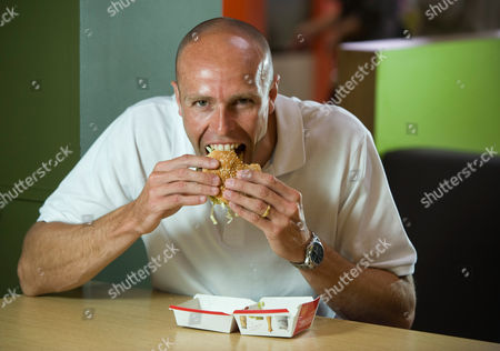 Former GB athlete Dean Macey eating a Big Mac in the Maidenhead branch of McDonald's
