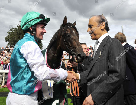 Jockey Ian Mongan and Prince Khalid Abdullah, owner of Twice Over celebrate after the horse won The Juddmonte International Stakes
