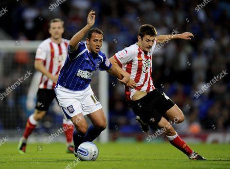 Michael Chopra of Ipswich Town and Adam Lallana of Southampton