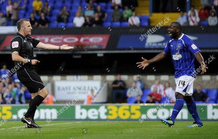 Jason Scotland of Ipswich Town reacts to Referee Jonathan Moss