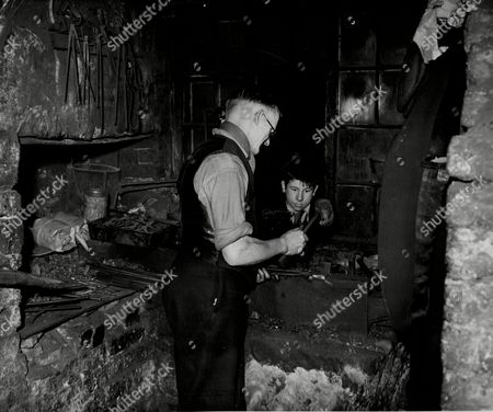Stock Image of George Watts Blacksmith Pictured In His Forge