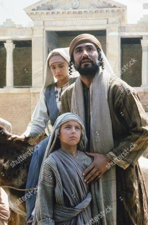 Stock Photo of (l-r) Olivia Hussey as Mary, the mother of Jesus, Lorenzo Monet as Jesus aged 12 years, Yorgo Voyagis as Joseph
