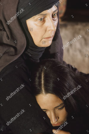 Stock Picture of (l-r) Regina Bianchi as Saint Anne, Olivia Hussey as Mary, the mother of Jesus, Marina Berti as Elizabeth --