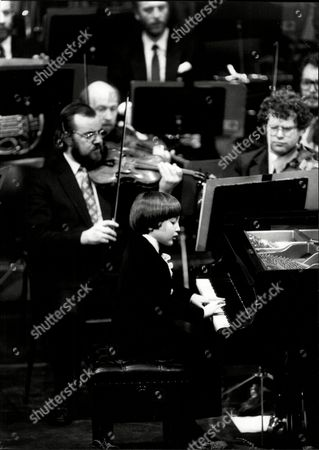 Editorial photo of Child Prodigy Young Frederick Kempf (8) Plays With Royal Philharmonic Orchestra With Conductor Arthur Davison