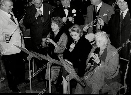 Conductor Herman Lindars Rehearses Dance Band Leader Edmundo Ros Lord Boothby Cliff Michelmore Sir Leonard Hutton Katie Boyle Moira Lister And Margaret Rutherford At The Royal Albert Hall For A Christmas Concert.