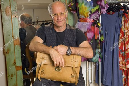 Roger Saul holding his first Mulberry creation, a briefcase, at his new retail development in Shepton Mallet.