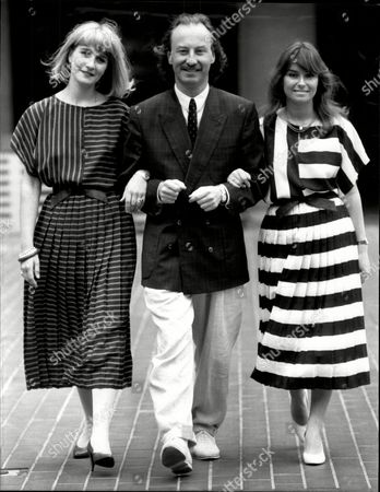 Editorial picture of New Summer Uniforms For Stock Exchange Guides. Designer Roland Klein With Pamela Allen And Theresa Harris