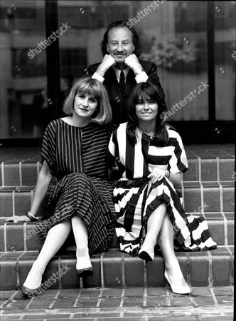 Stock Photo of New Summer Uniforms For Stock Exchange Guides. Designer Roland Klein With Pamela Allen And Theresa Harris