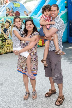 Stock Picture of Nina Wadia and Raiomond Mirza with children Tia and Aidan Mirza