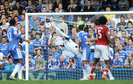 Chelsea goalkeeper Henrique Hilario denies Somen Tchoyi of West Bromwich Albion with a flying save