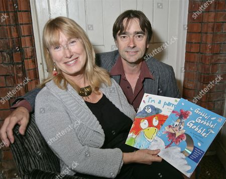 Stock Photo of Hilary James and Simon Mayer with copies of children's CD books for which they provided the music