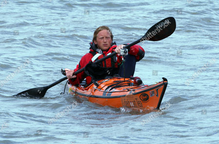 Editorial photo of Prince Harry meets members of the Suffolk Foundation and families of participants in the Englandvaarders kayak crossing, Sizewell Beach, Suffolk, Britain - 24 Aug 2011