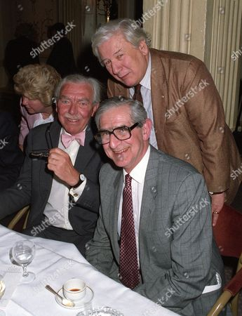 Frank Muir, Peter Ustinov and Dennis Norden at a charity dinner, London, Britain