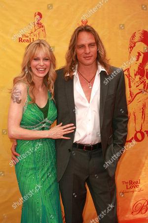 Kristin Bauer and husband Abri van Straten