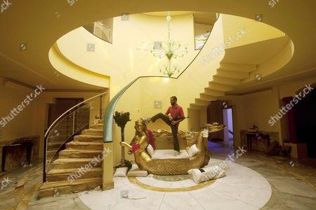 A golden mermaid shaped sofa at the entrance of the home of Aisha, daughter of Gaddafi