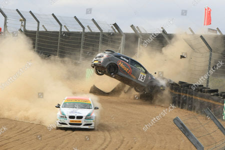 Stock Picture of Joseph Girling Vauxhall Astra smashes into the barriers after hitting Rob Smith's diesel BMW 330