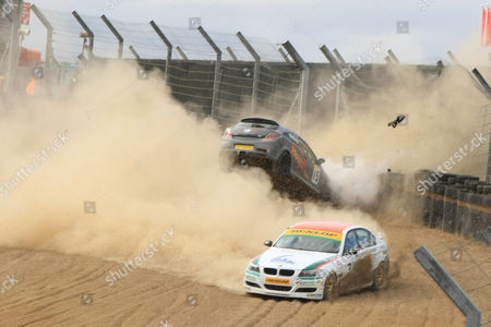 Stock Photo of Joseph Girling Vauxhall Astra smashes into the barriers after hitting Rob Smith's diesel BMW 330