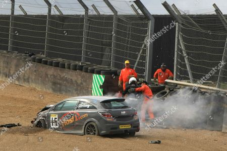 Joseph Girling is helped out of his Vauxhall Astra after the crash
