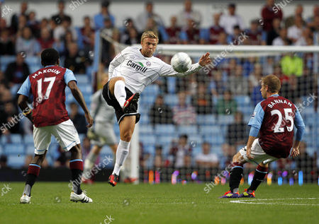 Nicky Featherstone of Hereford United takes on Jean Makoun of Aston Villa and Barry Bannan
