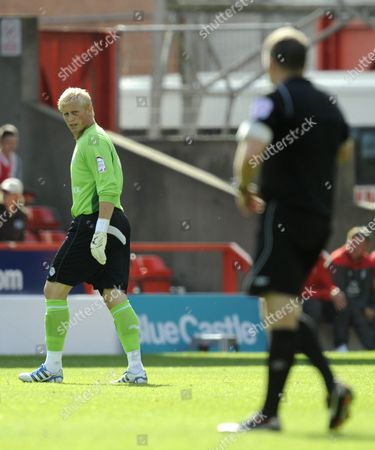 Leicester City goalkeeper Kasper Schmeichel looks angrily at referee J Moss after being sent off