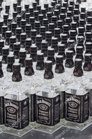 Thousands of Jack Daniel bottles are used to set a world record for the Largest Glass Bottle Mosiac during the Jack Daniel's Birthday Bash at the South Street Seaport. The mosaic created by artist Herb Williams set the record for Largest Bottle Mosaic made with 2120 bottles.